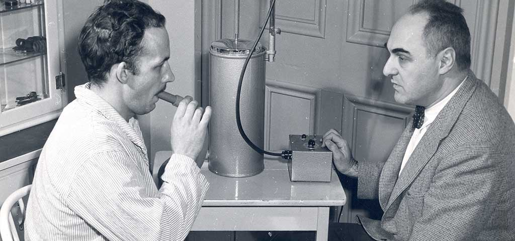 Albert Aranson, MD performing a pulmonary function test using the Collins Respirometer